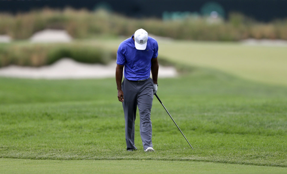 Photo - Tiger Woods reacts after a shot on the second hole during the first round of the U.S. Open golf tournament at Merion Golf Club, Thursday, June 13, 2013, in Ardmore, Pa. (AP Photo/Darron Cummings)
