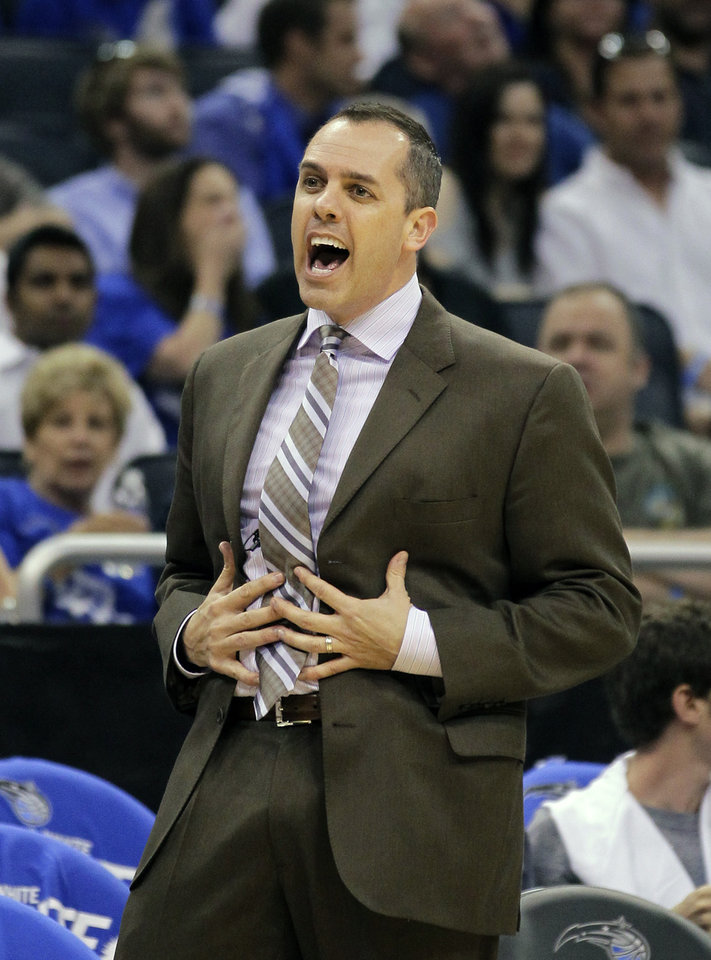 Photo -   Indiana Pacers head coach Frank Vogel questions a call by an official during the second half of Game 3 of an NBA first-round playoff basketball series against the Orlando Magic, Wednesday, May 2, 2012, in Orlando, Fla. Indiana won 97-74. (AP Photo/John Raoux)