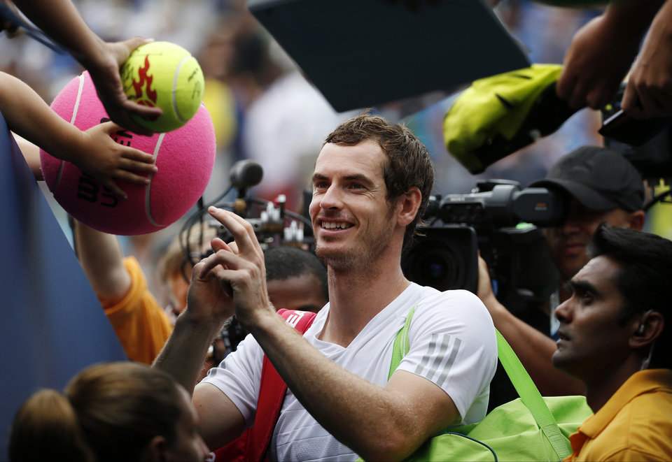 Photo - Andy Murray, of the United Kingdom, signs autographs after defeating Andrey Kuznetsov, of Russia, during the third round of the 2014 U.S. Open tennis tournament, Saturday, Aug. 30, 2014, in New York. (AP Photo/Kathy Willens)