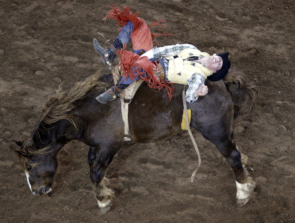 Photo - Trey Moore of Anniston, Ala., during the International Finals Rodeo at the State Fair Arena in Oklahoma City, Friday, Jan. 17, 2014.  Photo by Sarah Phipps, The Oklahoman