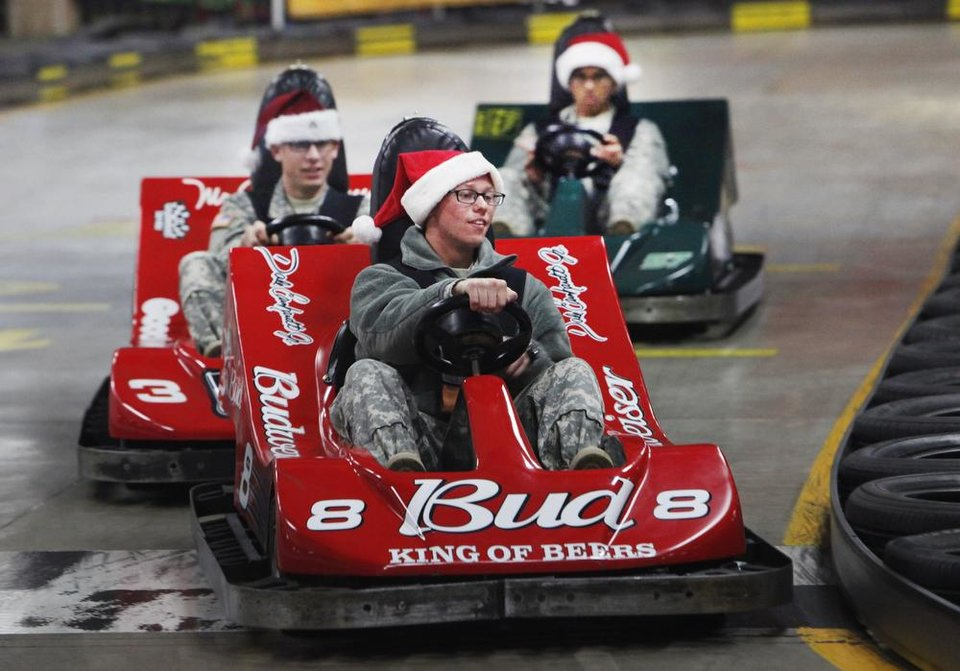 New recruits drive the go-carts at Gatti Town during Soldiers Day Out, Friday, December 21, 2012. Edmond/North OKC Blue Star Mothers will be taking the soldiers who can't go home for Christmas around the metro for a day of fun. Photo By David McDaniel/The Oklahoman