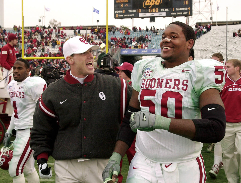 UNIVERSITY OF OKLAHOMA vs UNIVERSITY OF ARKANSAS COLLEGE FOOTBALL AT COTTON BOWL  OU co-defensive coordinator Brent Venables celebrates with offensive lineman Vince Carter following OU's win over Arkansas in the Cotton Bowl on Tuesday, Jan. 1, 2002.    Staff photo by Jim Beckel