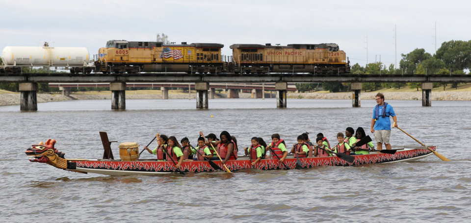 Photo -  Elementary school students row their dragon boat on the Oklahoma River. [Photo By Steve Gooch, The Oklahoman]