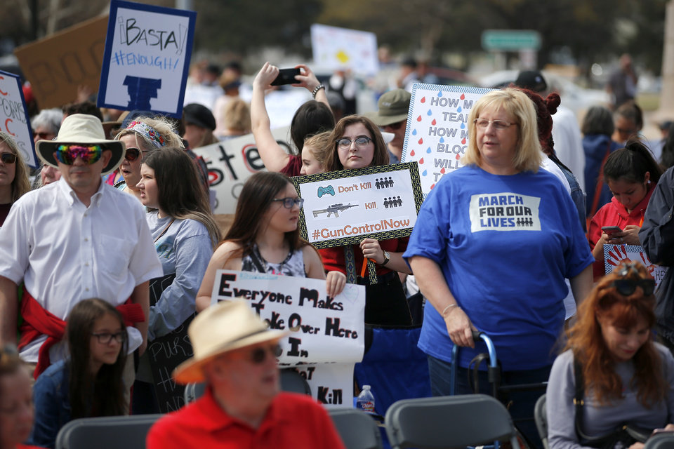 "Photo - People gather outside the state Capitol during a ""March for Our Lives"" rally in support of gun control in Oklahoma City, Saturday, March 24, 2018. Photo by Bryan Terry, The Oklahoman"