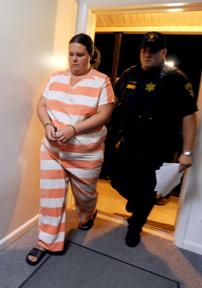 Photo - In this Friday, Aug. 15, 2014 photo, a deputy from the St. Lawrence County Sheriff's Department escorts Nicole F. Vaisey, into the courthouse for her arraignment on first-degree kidnapping charges at Fowler Town Court in Fowler, N.Y. Vaisey and Stephen M. Howells II, who were accused of kidnapping two young Amish sisters, were prowling for easy targets and may have also planned to abduct other children, St. Lawrence County Sheriff Kevin Wells said Saturday. (AP Photo/Watertown Daily Times, Melanie Kimber Lago) MANDATORY CREDIT, SYRACUSE OUT