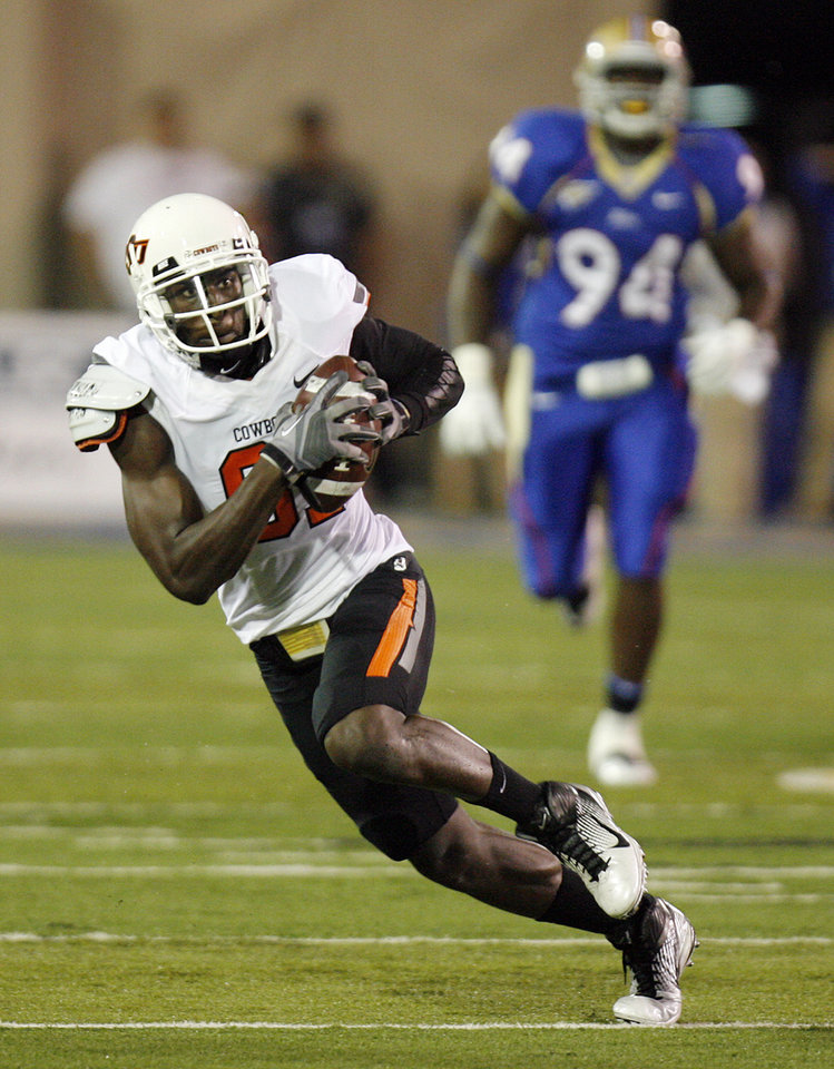 Photo - OSU's Justin Blackmon (81) runs after a catch in the first quarter during a college football game between the Oklahoma State University Cowboys and the University of Tulsa Golden Hurricane at H.A. Chapman Stadium in Tulsa, Okla., Sunday morning, Sept. 18, 2011. Photo by Nate Billings, The Oklahoman