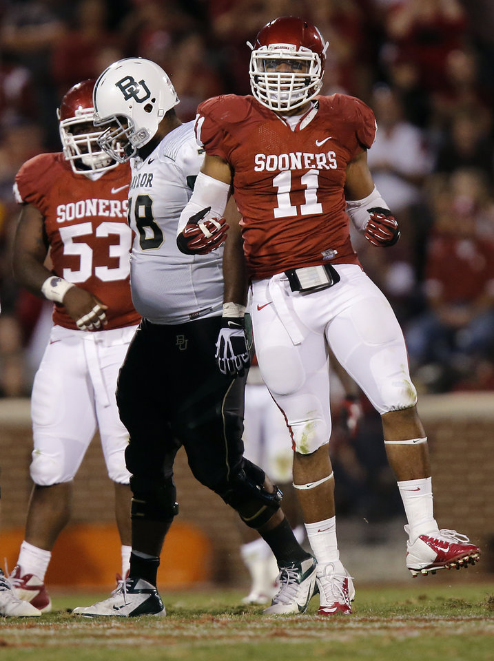 Photo - Oklahoma's R.J. Washington (11) reacts after a sack during the college football game between the University of Oklahoma Sooners (OU) and Baylor University Bears (BU) at Gaylord Family - Oklahoma Memorial Stadium on Saturday, Nov. 10, 2012, in Norman, Okla.  Photo by Chris Landsberger, The Oklahoman