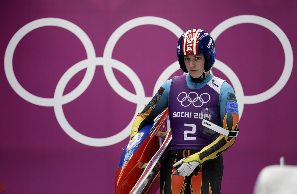 Photo - Erin Hamlin of the United States prepares to start a run during a training session for the women's singles luge at the 2014 Winter Olympics, Saturday, Feb. 8, 2014, in Krasnaya Polyana, Russia. (AP Photo/Natacha Pisarenko)