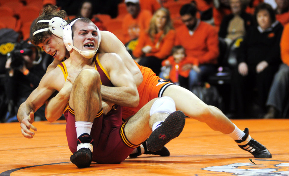 Photo - Oklahoma State 157-pound wrestler Alex Dieringer takes down Iowa State's John Nicholson at a wrestling dual between Oklahoma State and Iowa State at Gallagher Iba Arena in Stillwater on January 24, 2014. Oklahoma State defeated Iowa State 29-3. Photo by KT King/For the Oklahoman
