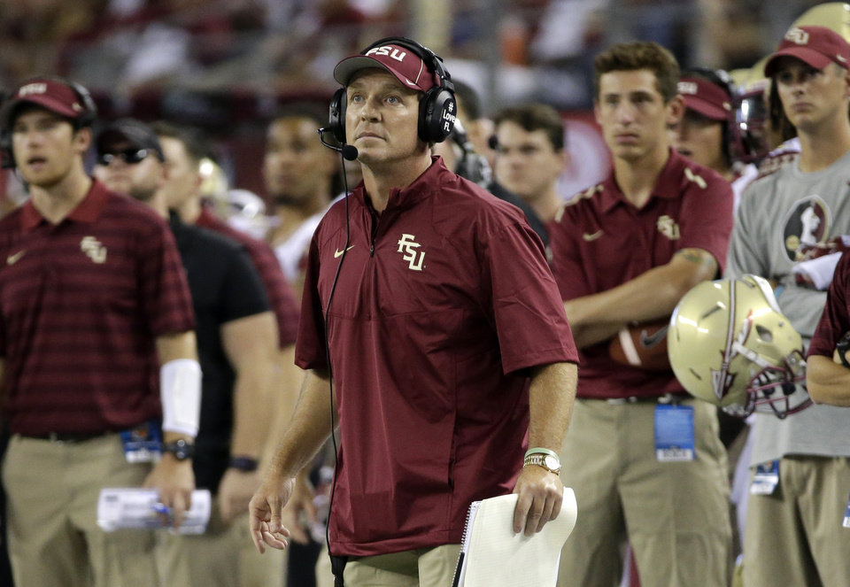 Photo - Florida State coach Jimbo Fisher watches an extra point by his team against Oklahoma State in the second half of an NCAA college football game, Saturday, Aug. 30, 2014, in Arlington, Texas. (AP Photo/Tony Gutierrez)
