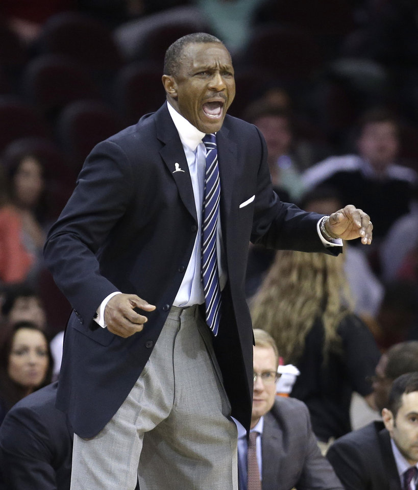 Photo - Toronto Raptors coach Dwane Casey yells to his team during the fourth quarter of an NBA basketball game against the Cleveland Cavaliers on Tuesday, March 25, 2014, in Cleveland. Cleveland defeated Toronto 102-100. (AP Photo/Tony Dejak)