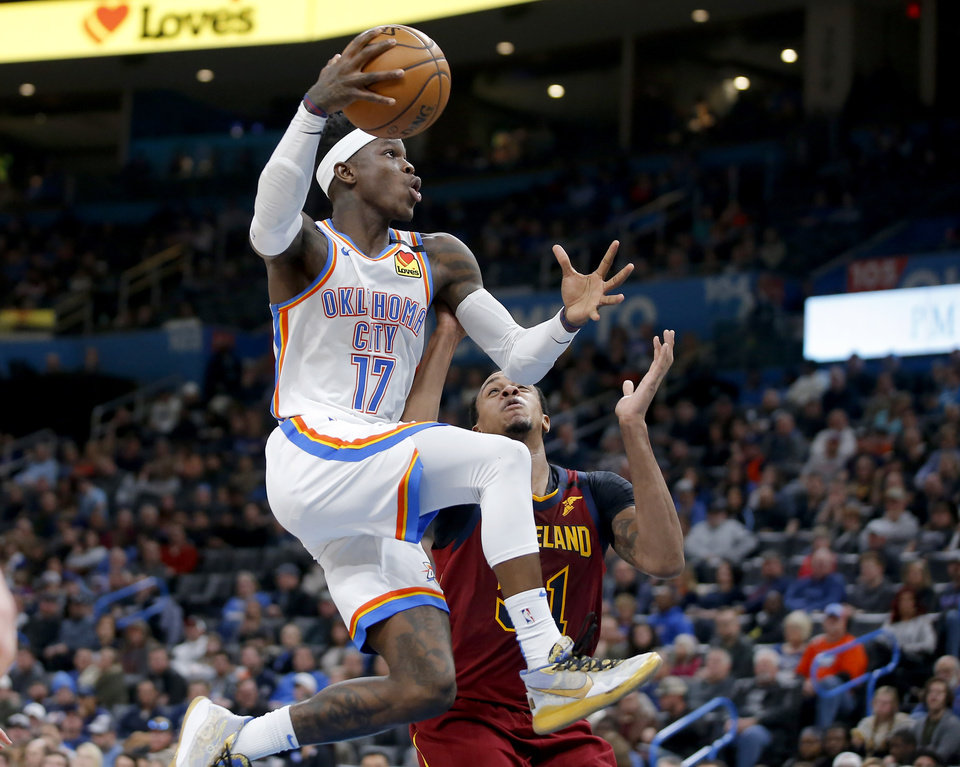 Photo - Oklahoma City's Dennis Schroder (17) goes past Cleveland's John Henson (31) during an NBA basketball game between the Oklahoma City Thunder and the Cleveland Cavaliers at Chesapeake Energy Arena in Oklahoma City, Wednesday, Feb. 5, 2020. [Bryan Terry/The Oklahoman]