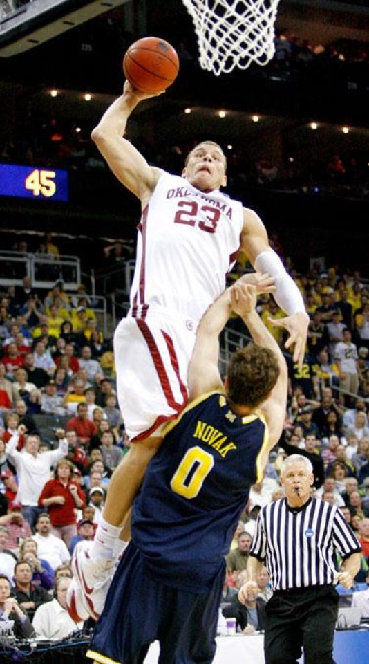 Photo -  OU's Blake Griffin dunks the ball over Michigan's Zack Novak during a second-round men's NCAA college basketball tournament game between Oklahoma and Michigan in Kansas City, Mo., Saturday, March 21, 2009. PHOTO BY BRYAN TERRY, THE OKLAHOMAN