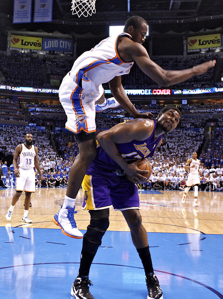 Oklahoma City\'s Serge Ibaka goes over the top of Los Angeles\' Andrew Bynum to commit a foul during Game 2 in the second round of the NBA playoffs between the Oklahoma City Thunder and the L.A. Lakers at Chesapeake Energy Arena on Wednesday, May 16, 2012, in Oklahoma City, Oklahoma. Photo by Chris Landsberger, The Oklahoman