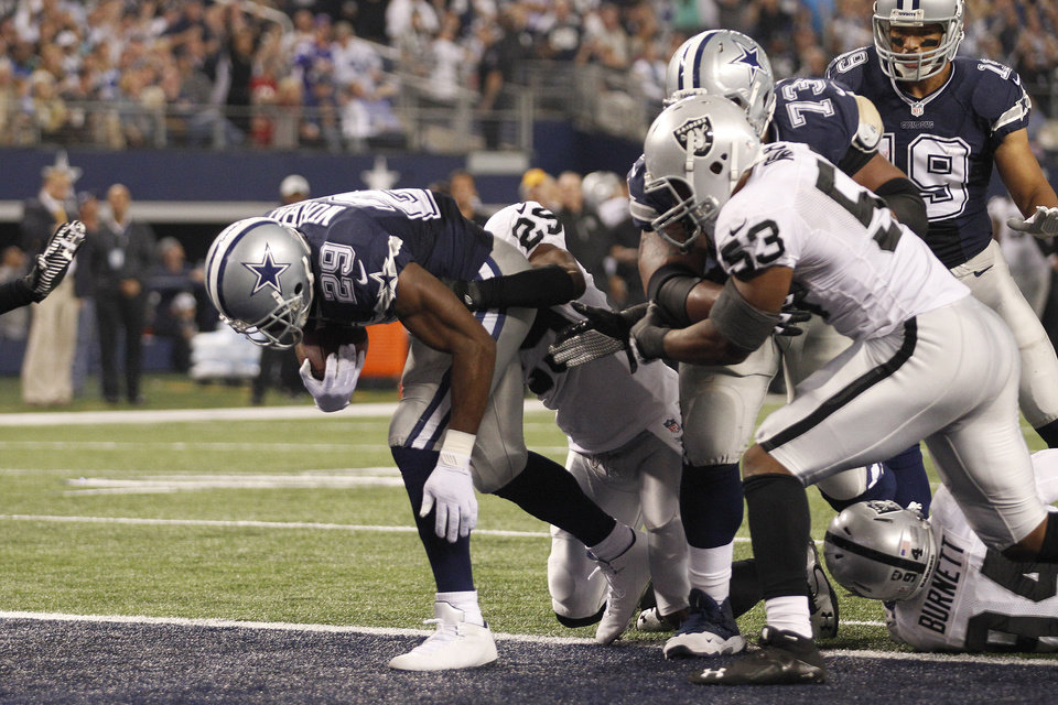 Photo - Dallas Cowboys running back DeMarco Murray (29) scores a touchdown against the Oakland Raiders during the first half of an NFL football game, Thursday, Nov. 28, 2013, in Arlington, Texas.  (AP Photo/Tim Sharp)