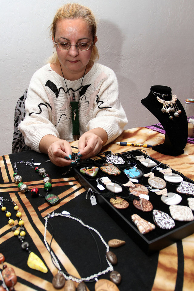 Artist Day Berndt displays her jewelry at an arts market in Norman Saturday.