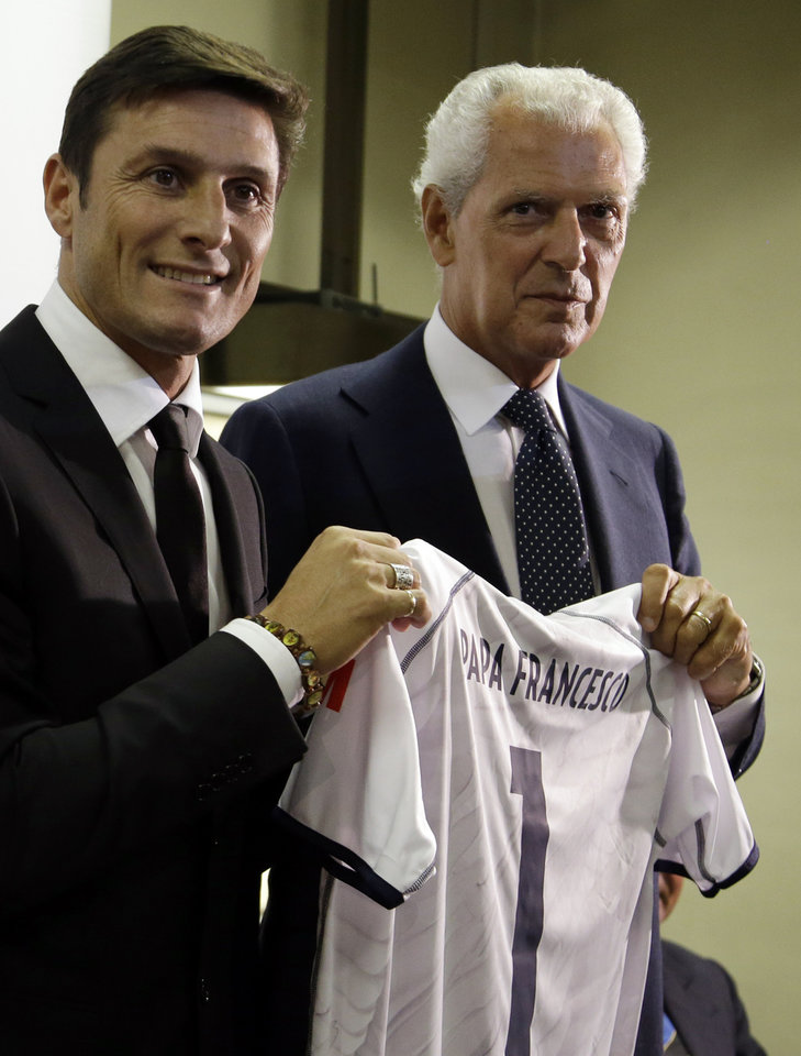 Photo - Inter of Milan Vice-President Javier Zanetti, left, and Italian Entrepreneur Marco Tronchetti Provera hold a soccer jersey bearing the name of Pope Francis as they pose for the photographers prior to the start of a press conference presenting a inter-religious football match for peace, in Rome, Monday, Aug. 25, 2014. The friendly soccer match, supported by Pope Francis to promote the dialogue and peace among different religions, is scheduled at Rome's Olympic stadium, Sept. 1. (AP Photo/Gregorio Borgia)