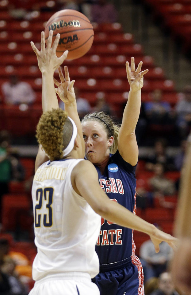 Photo - Fresno State guard Taylor Thompson (33) shoots against California guard Layshia Clarendon (23) during the first half of a first-round game in the women's NCAA college basketball tournament in Lubbock, Texas, Saturday, March 23, 2013. (AP Photo/LM Otero)