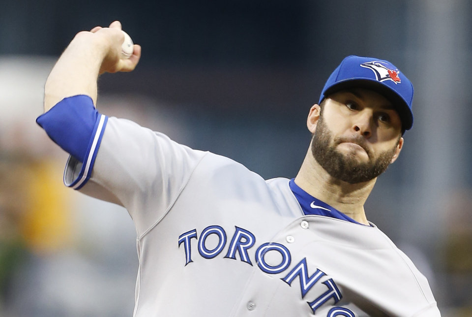Photo - Toronto Blue Jays starting pitcher Brandon Morrow (23) throws against the Pittsburgh Pirates in the first inning of a baseball game on Friday, May 2, 2014, in Pittsburgh. (AP Photo/Keith Srakocic)