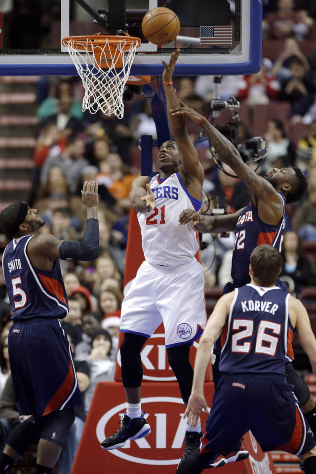 Philadelphia 76ers' Thaddeus Young (21) goes up for a shot against Atlanta Hawks' Josh Smith (5), DeShawn Stevenson (92) and Kyle Korver (26) during the first half of an NBA basketball game, Friday, Dec. 21, 2012, in Philadelphia. (AP Photo/Matt Slocum)
