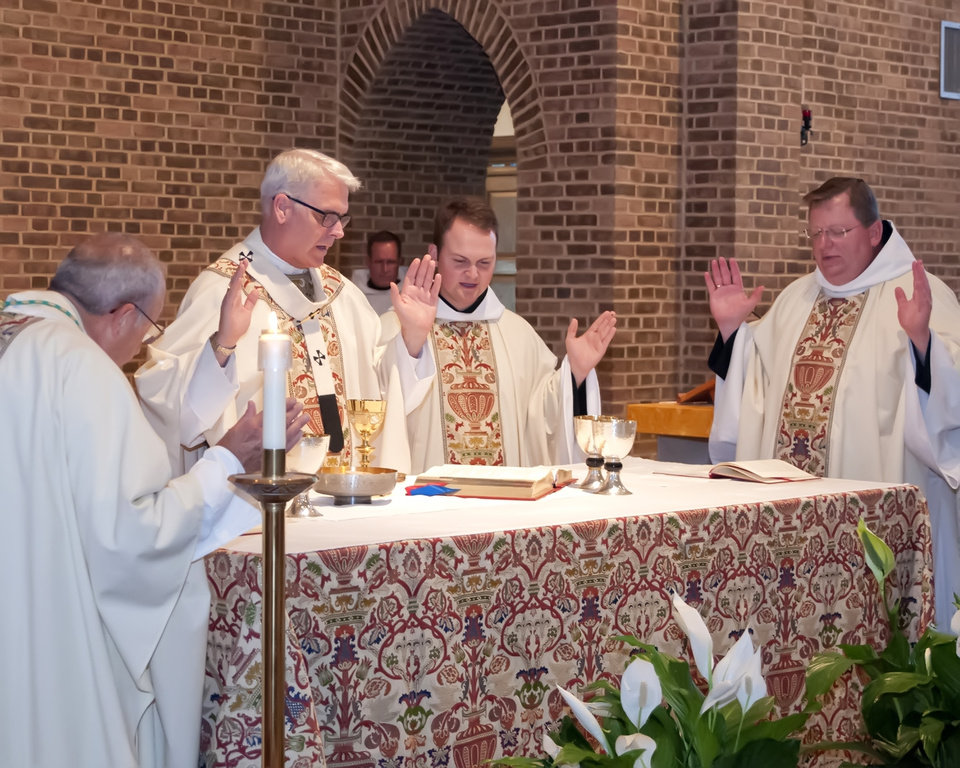 Photo - From left, the Most Rev. Eusebius J. Beltran, archbishop emeritus of the Archdiocese of Oklahoma City, the Most Rev. Paul S. Coakley, archbishop of the Archdiocese of Oklahoma City, the Rev. Simeon Spitz and St.  Gregory's Abbey Abbot Lawrence Stasyzen participate in Spitz's ordination ceremony  on May 31  at St. Gregory's Abbey in  Shawnee.  Photo by Vincent R. Vitale