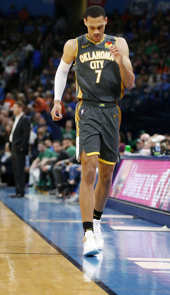 Photo - Oklahoma City's Darius Bazley (7) leaves the floor after injuring his knee in the first quarter during an NBA basketball game between the Oklahoma City Thunder and the Boston Celtics at Chesapeake Energy Arena in Oklahoma City, Sunday, Feb. 9, 2020. [Nate Billings/The Oklahoman]