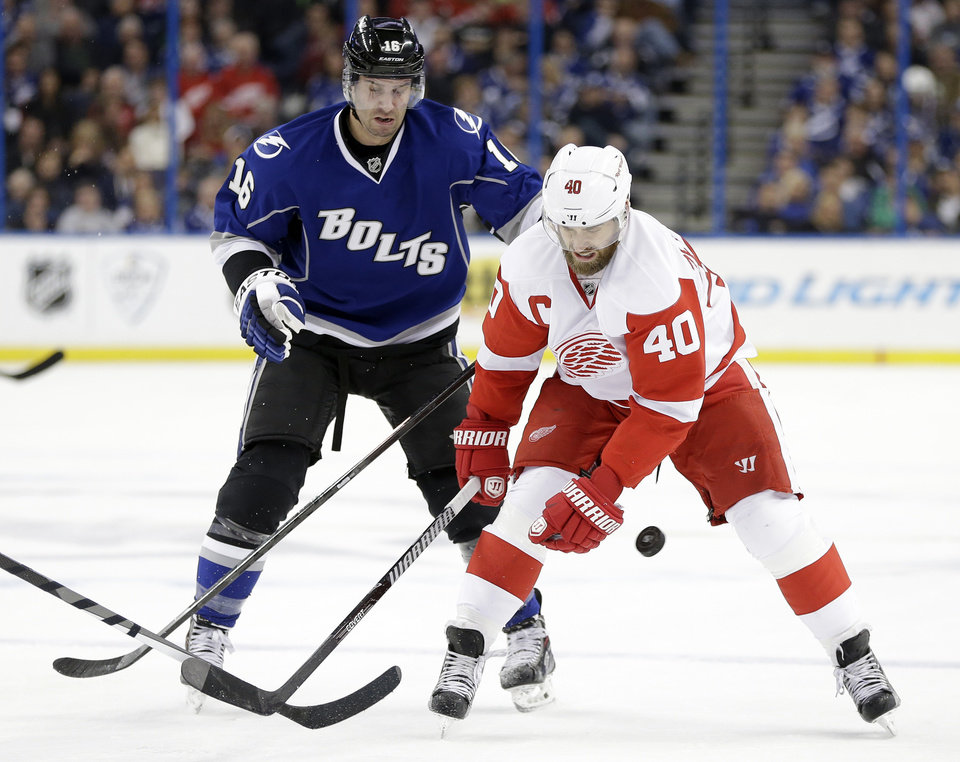 Photo - Detroit Red Wings left wing Henrik Zetterberg (40) loses the puck as he attempts to get around Tampa Bay Lightning right wing Teddy Purcell (16) during the first period of an NHL hockey game Saturday, Feb. 8, 2014, in Tampa, Fla. (AP Photo/Chris O'Meara)