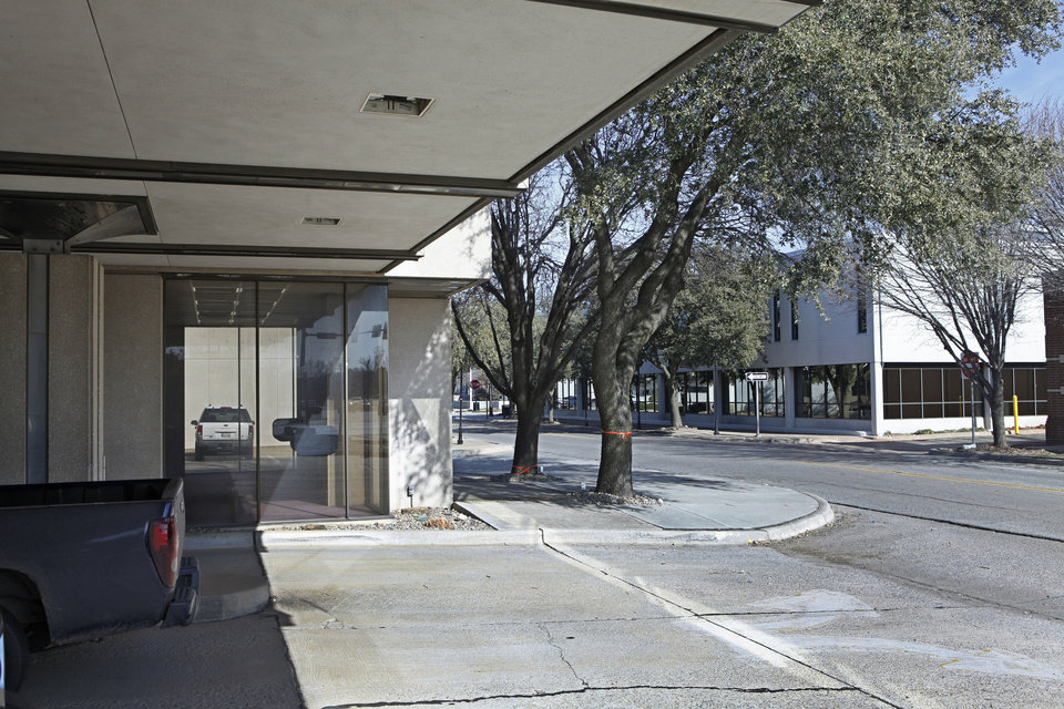 Photo - A bank drive-thru, at Second Street and Littler Avenue, and the administration building, 100 E First St., seen in the background, will be torn down to make room for the new public safety center. PHOTO BY DAVID MCDANIEL, THE OKLAHOMAN.  David McDaniel - THE OKLAHOMAN