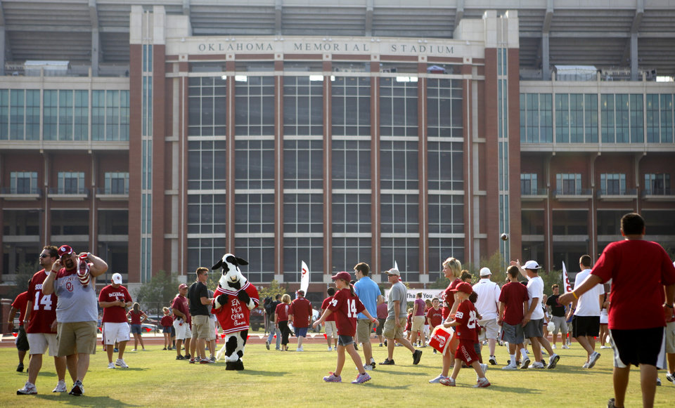 A crowd gathers during Fan Fest before the college football game between the University of Oklahoma Sooners (OU) and the Tulsa University Hurricanes (TU) at the Gaylord Family-Memorial Stadium on Saturday, Sept. 3, 2011, in Norman, Okla. 