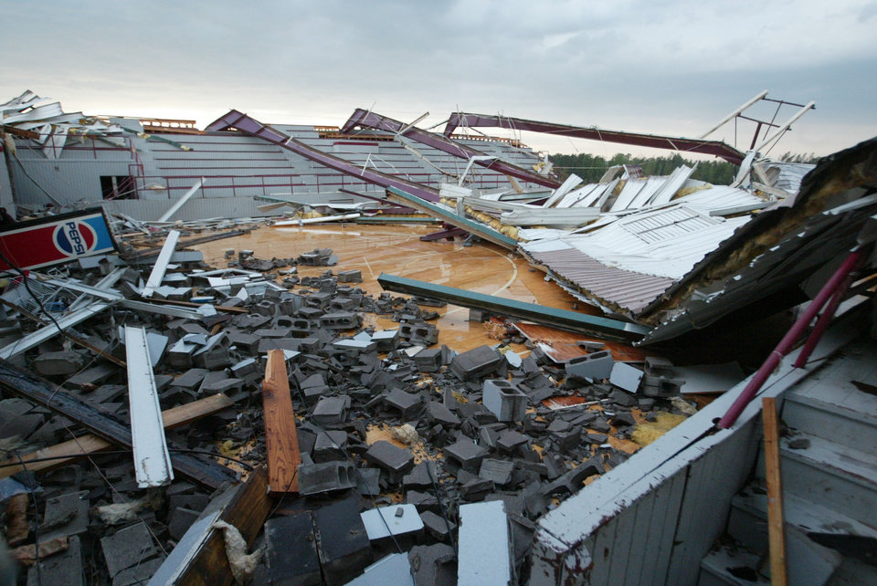 Photo - The Smithville High School gym and the rest of the school were completely destroyed following a tornado, Wednesday, April 27, 2011 in Smithville, Miss.(AP Photo, Northeast Mississippi Daily Journal, Thomas Wells)