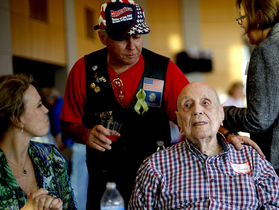 Photo - Sam Anderson watches her father, retired Col. John R. Burks talk with Vietnam-era Army veteran Huey Daniels as they wait for the start of an Oklahoma Honor Flight send-off ceremony at Rose State College in Midwest City, Okla., Tuesday, October 7, 2014. Photo by Bryan Terry, The Oklahoman