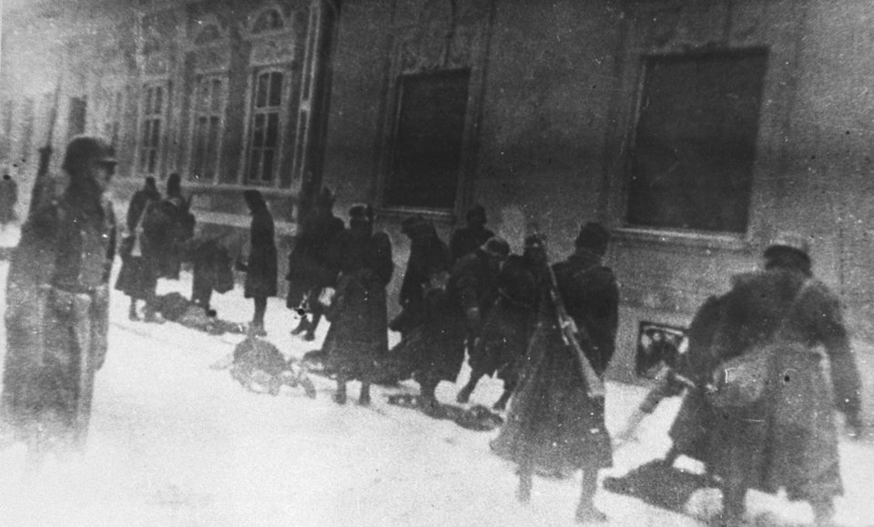 Photo - This photo provided by United States Holocaust Memorial Museum shows Hungarian soldiers as they execute Serbians and Jews on Miletic Street in Novi Sad, Yugoslavia, Jan. 23, 1942, during a series of