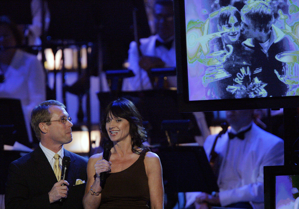 Photo - Husband and wife Bart Conner and Nadia Comaneci speak on stage during the Centennial Spectacular to celebrate the 100th birthday of the State of Oklahoma at the Ford Center on Friday, Nov. 16, 2007, in Oklahoma City, Okla. Photo By CHRIS LANDSBERGER, The Oklahoman