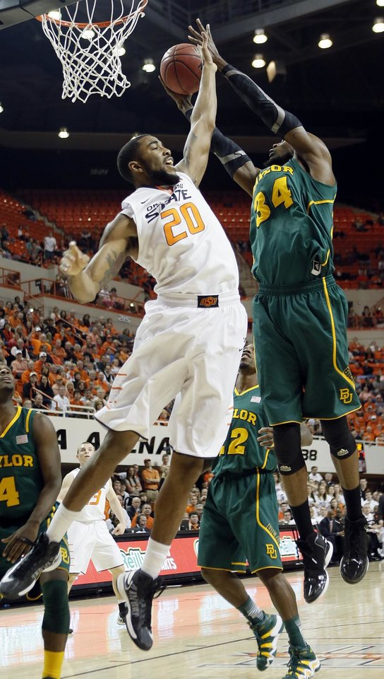 Oklahoma State 's Michael Cobbins (20) defends under the basket against Baylor's Cory Jefferson (34) during the college basketball game between the Oklahoma State University Cowboys (OSU) and the Baylor University Bears (BU) at Gallagher-Iba Arena on Wednesday, Feb. 5, 2013, in Stillwater, Okla. Photo by Chris Landsberger, The Oklahoman