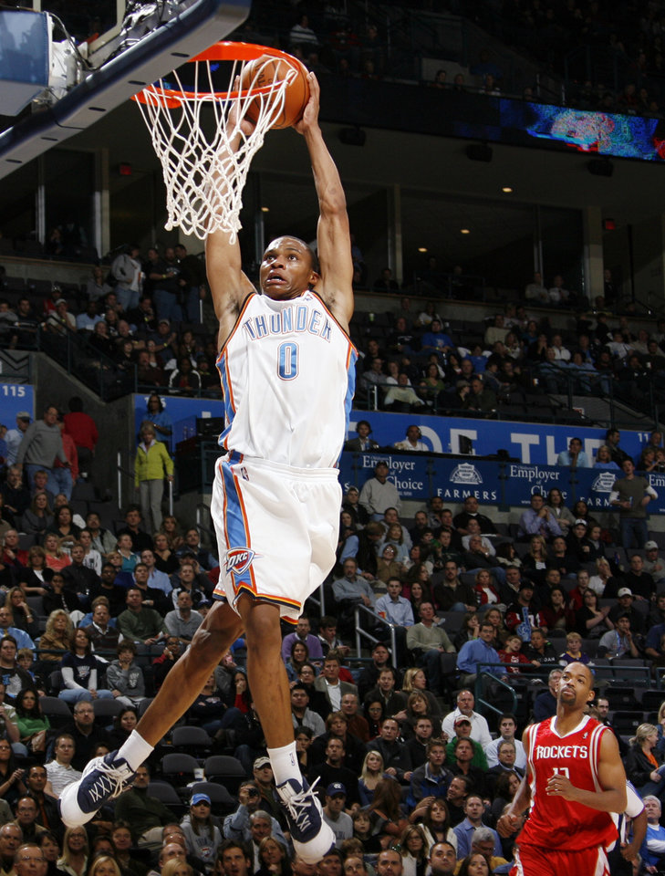 Photo - Oklahoma City's Russell Westbrook dunks the ball in front of Houston's Rafer Alston in the second half of the NBA basketball game between the Oklahoma City Thunder and the Houston Rockets at the Ford Center in Oklahoma City, Monday, Nov. 17, 2008. Houston won, 100-89. BY NATE BILLINGS, THE OKLAHOMAN ORG XMIT: KOD