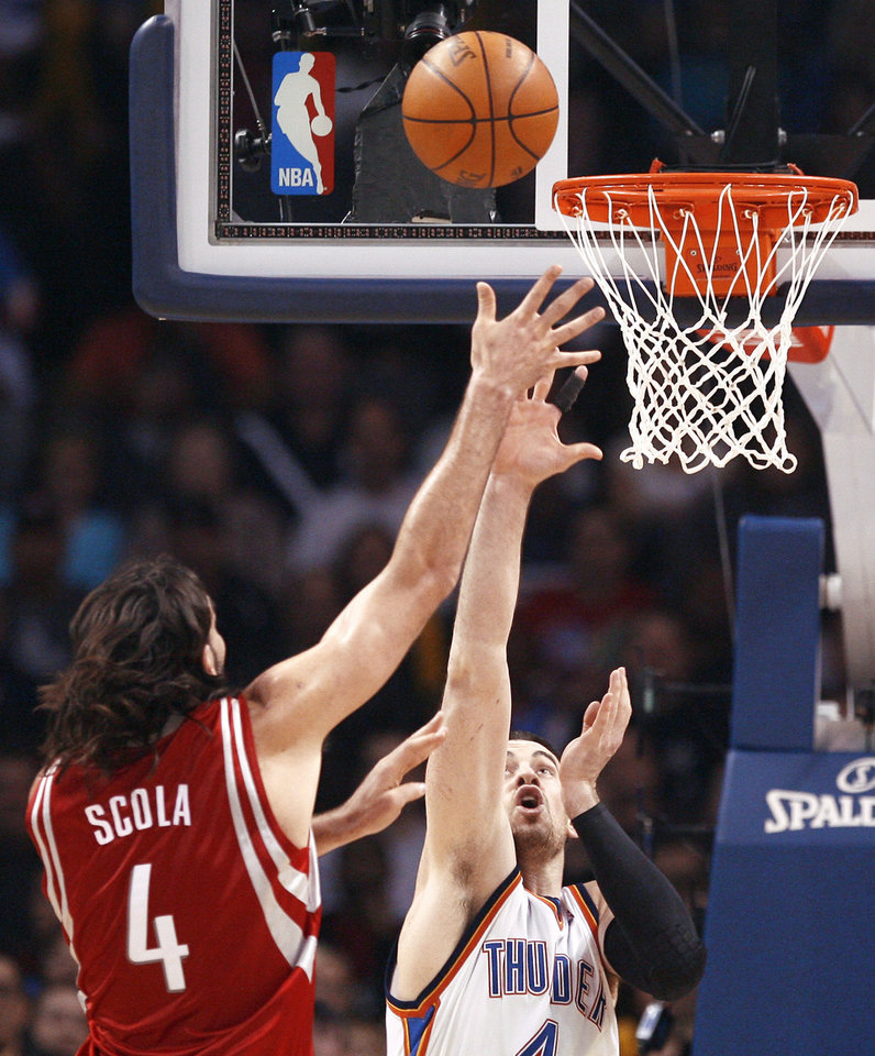 Photo - Oklahoma City's Nick Collison, right, defends against Houston's Luis Scola during Wednesday's game at the Ford Center.  Photo by Sarah Phipps, The Oklahoman