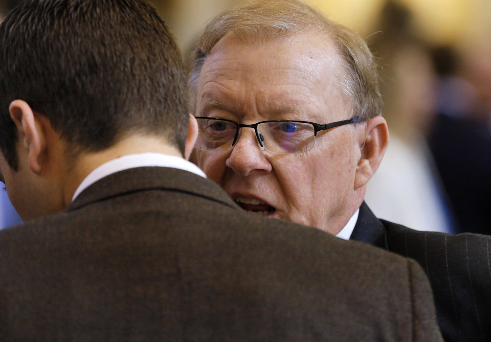 Photo - Rep. Earl Sears, chairman of House and appropriations and budget committee talks to a fellow lawmaker before the start of the Oklahoma Legislature's 2016 State-of-the-State Address by Gov. Mary Fallin in the chamber of the House of Representatives at the Oklahoma state capitol on Monday, Feb. 1, 2016, in Oklahoma City, Okla. Photo by Jim Beckel, The Oklahoman