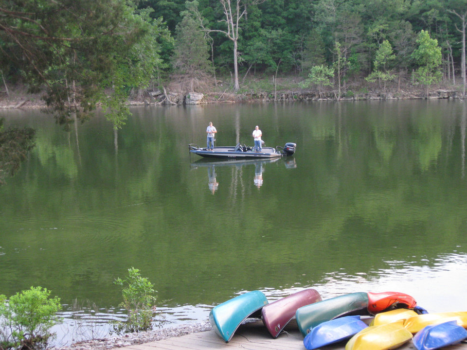 Photo - Two men fish near the boat dock of Stonewater Cove resort. PHOTO BY PAULA BURKES, THE OKLAHOMAN