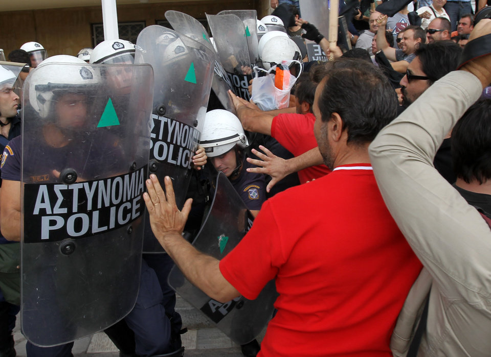 Riot police clash with protesters inside Greece\'s Defense Ministry in Athens, Thursday, Oct. 4, 2012. Police clashed with scores of protesting shipyard workers after they forced their way into the grounds of Greece\'s Defense Ministry. The workers say they have not been paid in months. (AP Photo/Thanassis Stavrakis)