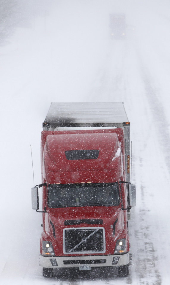 Photo - A tractor trailer drives south on I-35 near Guthrie , February  9 , 2011. Photo by Steve Gooch, The Oklahoman