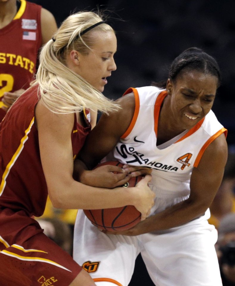 Photo - Oklahoma State's Brittany Atkins (1) fights Iowa State's Jadda Buckley (11) for a loose ball during the Women's Big 12 basketball tournament at  Chesapeake Energy Arena  in Oklahoma City, Okla., Saturday, March 8, 2014. Photo by Sarah Phipps, The Oklahoman