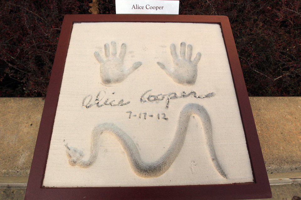 Alice Cooper's hand and snake prints are displayed in the Legends Plaza at the Detroit Historical Museum in Detroit, Wednesday, Nov. 21, 2012. The museum is reopening six months after the venerable institution in the city's cultural center closed up shop to undergo its first major renovation in a half-century. (AP Photo/Carlos Osorio)