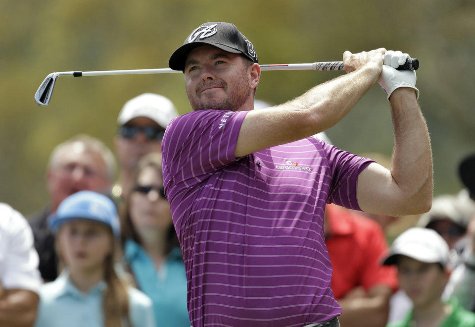 Photo - Robert Garrigus tees off on the second hole during the final round of the Valspar Championship golf tournament at Innisbrook, Sunday, March 16, 2014, in Palm Harbor, Fla. (AP Photo/Chris O'Meara)