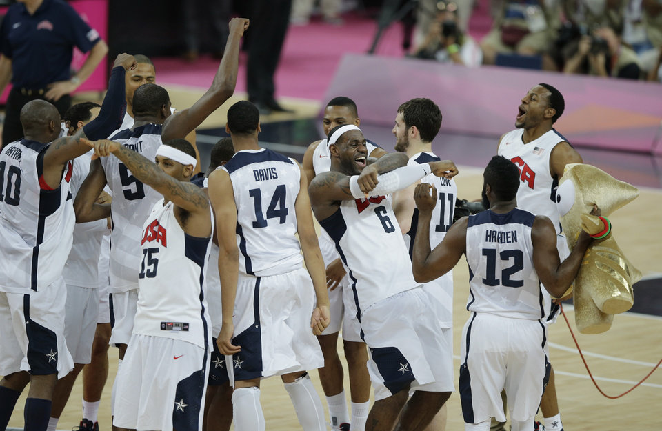 Members of the United States basketball team celebrate after defeating Spain in the men\'s gold medal basketball game at the 2012 Summer Olympics, Sunday, Aug. 12, 2012, in London. (AP Photo/Morry Gash)
