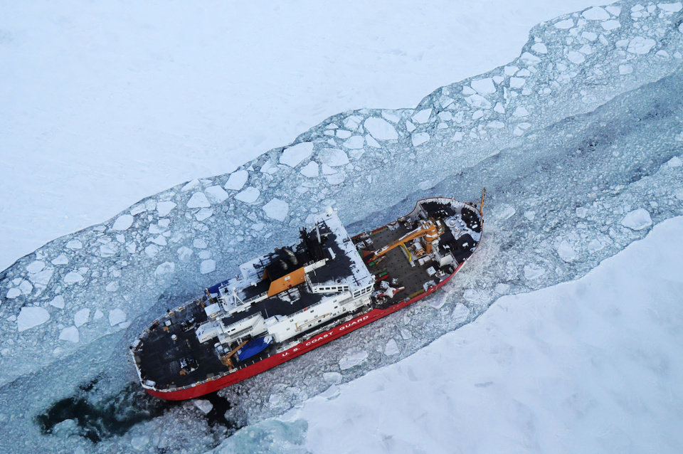Photo - In this Dec. 26, 2013 photo provided by the U.S. Coast Guard the icebreaker Mackinaw maintains a shipping lane on the St. Marys River linking Lakes Superior and Huron. It's been so bitterly cold for so long in the Upper Midwest that the Great Lakes are almost completely covered with ice. The last time they came this close was in 1994, when 94 percent of the lakes' surface was frozen. (AP Photo/U.S. Coast Guard