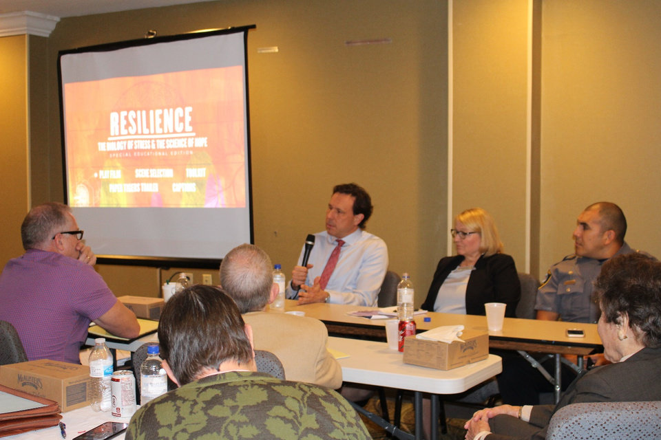 Photo - Ken Stoner, Oklahoma County District Judge; Sherry Fair, executive director of Parent Promise, and Paco Balderrama, Oklahoma City Police Deputy Chief, discuss the Resilience film during a training of guardian ad litems. [PROVIDED]