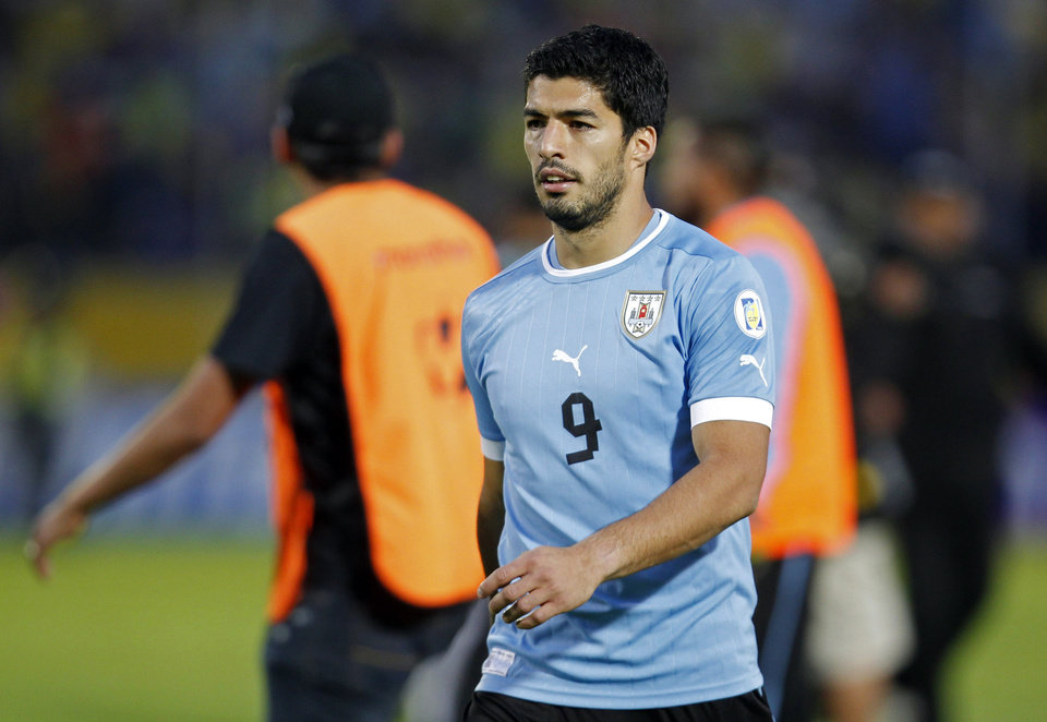 Photo - FILE - In this Friday, Oct. 11, 2013 file photo, Uruguay's Luis Suarez walks off the pitch at the end of a 2014 World Cup qualifying soccer game against Ecuador in Quito, Ecuador.  Uruguay striker Luis Suarez has undergone keyhole surgery on his knee and is expected to recover in time for the World Cup. The mother of the 27-year-old Liverpool striker says he had surgery Thursday to repair damage to his meniscus. Sandra Diaz tells The Associated Press that the surgery was successful and that he is expected to recover in 2-3 weeks. Uruguay plays its first match at the World Cup against Costa Rica on June 14. The team will then face England on June 19 and Italy on June 24. (AP Photo/Martin Mejia, file)