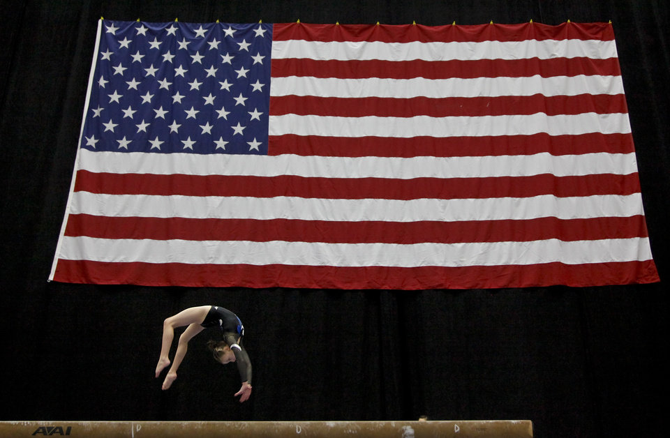 A competitor competes on the beam during the 2012 Nadia Comaneci International Invitational event in part of the Bart & Nadia Sports & Health Festival at the Cox Convention Center on Friday, Feb. 10, 2012, in Oklahoma City, Okla.  Photo by Chris Landsberger, The Oklahoman