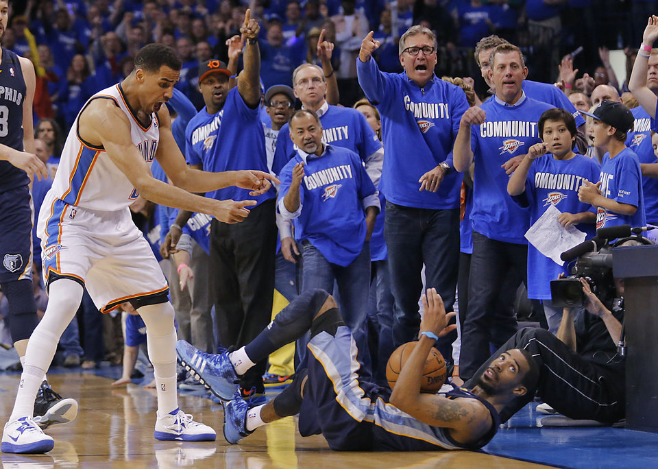 Oklahoma City\'s Thabo Sefolosha (2) and the fans react after Memphis\' Mike Conley (11) goes out of bounds for a turnover during the second round NBA playoff basketball game between the Oklahoma City Thunder and the Memphis Grizzlies at Chesapeake Energy Arena in Oklahoma City, Sunday, May 5, 2013. Photo by Chris Landsberger, The Oklahoman