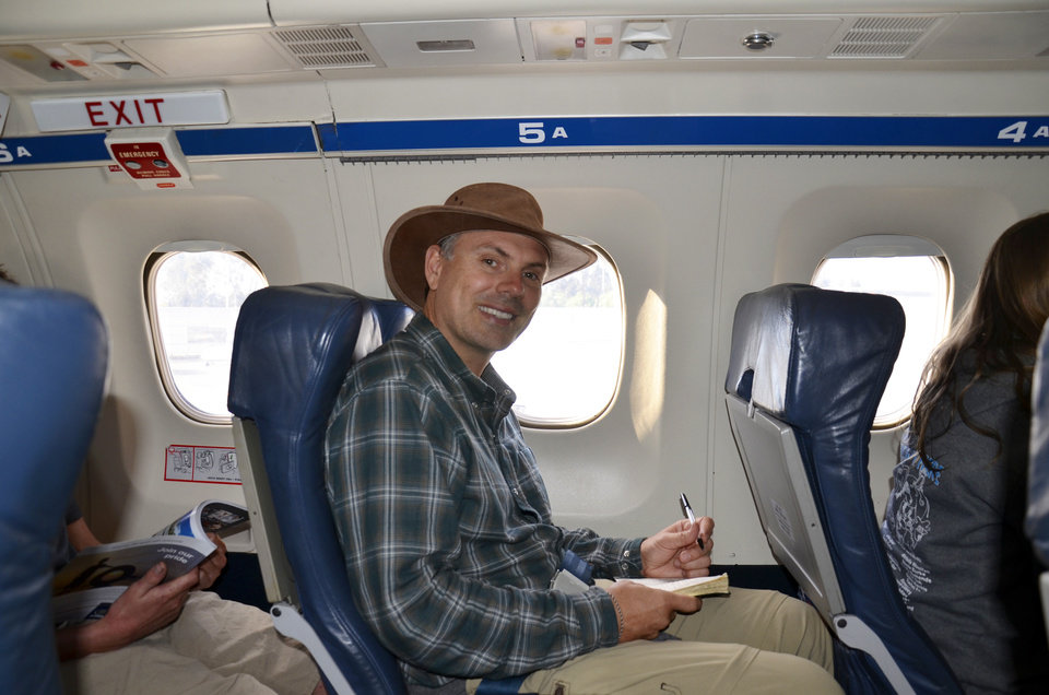 Photo -   This October 2012 photo supplied by John E. DiScala shows DiScala, better known as the travel writer and blogger Johnny Jet, founder of JohnnyJet.com, on a plane in Australia from Adelaide to Kangaroo Island. DiScala says he suffered from fear of flying as a young man but overcame it and now travels more than 150,000 miles a year. (AP Photo/John E. DiScala)
